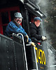 "Conway Scenic Railroad engineers, Bob Howland & Courtney Gregg, relax aboard steam engine #7470, during a photo stop of ""Steam In The Snow"", an annual event of The Massachusetts Bay Railroad Enthusiasts, and the Conway Scenic Railroad, of North Conway, NH, held on January 7th, 2012. The Mass Bay RRE, chartered the train, powered by the Steam Locomotive #7470, for a round-trip run from the North Conway train station, to The Notchland Inn, in Hart's Location. There were a number of photo stops during the trip."