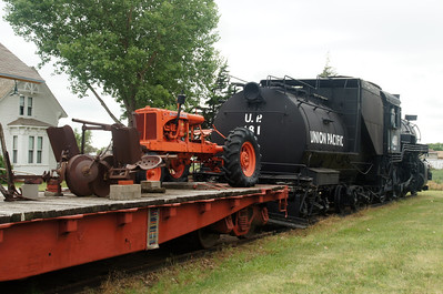 UP 481 on static display in Kearney, NE with a flat car of vintage farm equipment
