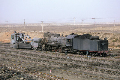 A JS engine and the spreader head out to the overburden area to clean off some tracks.