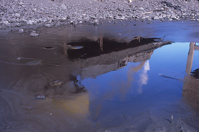 Waiting to have its 11 coal cars dumped, the JS waits at the washery and is reflected in a small pool of water.