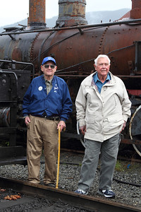 Here is a photo of Mr. Jim Gertz and friend. Jim worked at Rayonier when Willamette #2 ran her last miles. He bought #2 and moved her to his property in Port Angeles, WA. The same day the engine was unloaded on his property he had contractors build a building around it to keep it out of the weather. In 2002 he donated her to MRSR on the condition that we get her running again. Heartfelt gratitude to Mr. Gertz and thanks to Martin for this information.