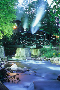 #6, a 3 truck Heisler, poses for a night shoot on the bridge.