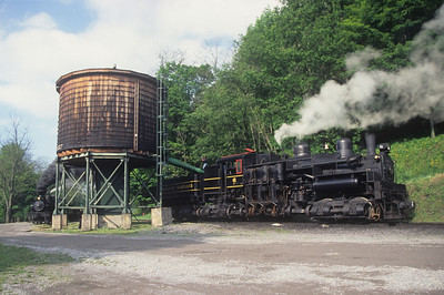 Massive @ 162 tons, Shay #6 takes on water at the Cass water tank.