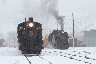 "A ""white out"" as both steam engines wait in the yard."