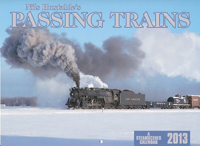 Nils Huxtable's PASSING TRAINS – Pere Marquette 2-8-4 No. 1225 in snow; Nevada Northern's Baldwin Ten-Wheeler; a PRR E8 at Scranton; Iowa Interstate 'GE-VO' ES44ACs; Wisconsin & Southern E9As; Amtrak's Empire Builder; Mississippian Ry. 2-8-0 No. 77; a 'Bloomer Line' GP9; Sierra Ry. 4-6-0 No. 3 at night; Keokuk Junction Railway A-B-A F9s powering the Canton Cannonball; N&W J-class 4-8-4 No. 611 on Blue Ridge; a BN manifest silhouetted on Mud Bay trestle.