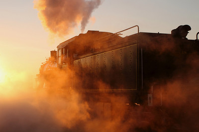 """Morning glint as #18 prepares to start the day and connect to the passenger cars used to transport rail fans on the """"Photographer's Special."""""""