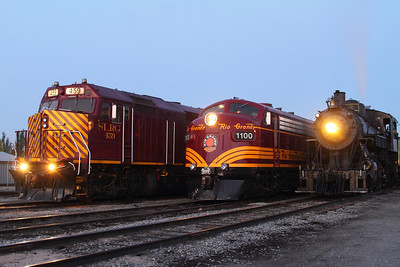 2 diesel locomotives, #459 and #1100, sit beside steam engine #18 in the early morning hours. Image taken in Alamosa, CO, close to the SLRG depot.
