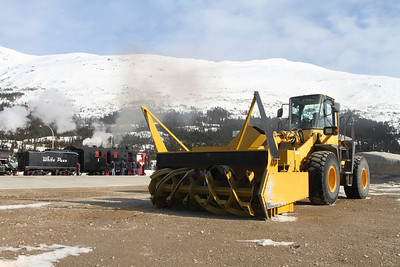 A snow plow and .....a snow plow. Two very different pieces of equipment, but they both get the job done.