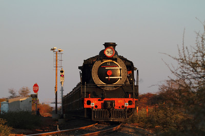 The last rays of light strike the nose of engine #12 as it heads back to the yard with a full load.