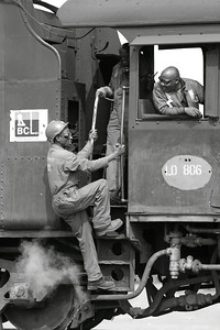 Hitching a ride: one of th train crew at the BCL mine in Botswana catches a ride as engine #6 passes through the yard.