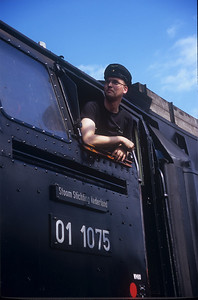 One of the crew on the 01 1075 looks out the window as the engine is worked on in Bochum, Germany (Museumstage im Eisenbahnmuseum Bochum-Dahlhausen).
