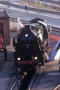 Getting ready for bed, the 52 8079-7 gets some time at the ash pit and then heads into the roundhouse after a long day.