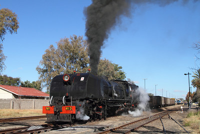 613, a Garratt class 16A, prepares to get underway with a mixed in Plumtree, Zimbabwe.