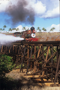 The 2-4-0 engine, known as Anaka, does a blowdown on the 325-foot curved wooden trestle.