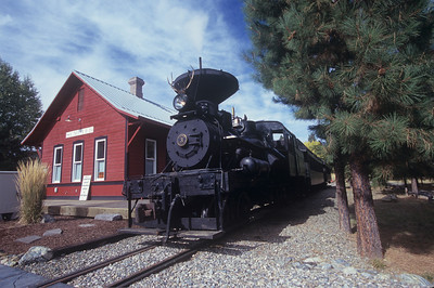 #3 waits at the Sumpter depot as riders enjoy a warm meal inside.