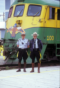 Two RCMP mounties keep a watchful eye to ensure that nobody steals locomotive #100 =;0)