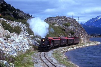 WP&Y steam locomotive #69 runs along Mountain Lake near Fraser, BC.