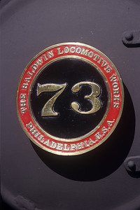 The number plate for steam engine #73: a 2-8-2 built by Baldwin in 1947.