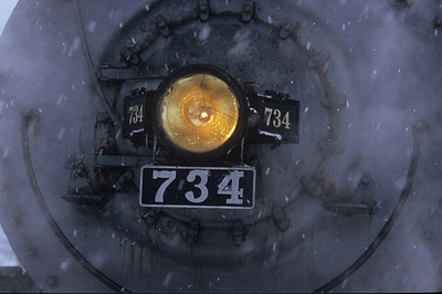 734's number plate and light in the snow.
