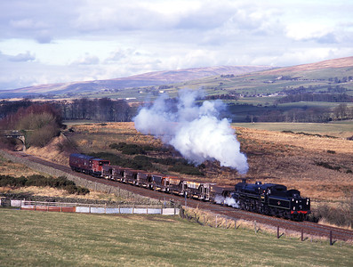 75019 worked a freight charter from Carnforth-Skipton on 26/2/00 seen near Clapham.