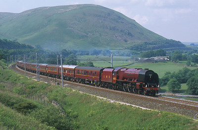 Running like a sewing machine, 6233 'Duchess of Sutherland' passes through the Lune Gorge. 14/6/03
