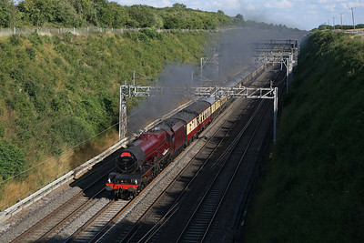 Only about eighty years since it first started to cover the WCML every day, 6201 'Princess Elizabeth' threads Tring Cutting on the way back to Birmingham from London. 17/7/10