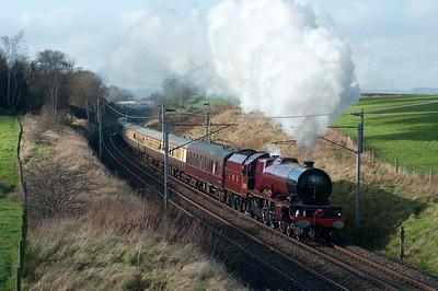 6201 Princess Elizabeth storms past Docker with a Tyseley-Glasgow charter 12/11/11.