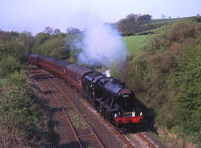 8F 48151 hauls a Wigan-Scarborough special at Keer Holme 6/5/00.