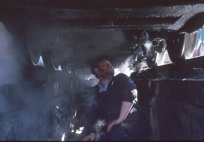 The dirty job that someone has to do - a scene underneath 34072 '257 Squadron' in steam at Swanage. 15/3/95