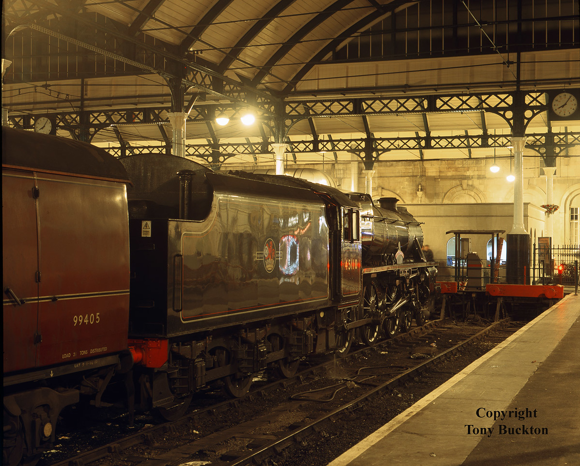 "On the evening of Tuesday 16th February 1999 45110 stands under the trainshed of Hull Paragon having just arrived with a circular dining tour of Yorkshire which encompassed Selby, Gascoigne Wood and Knottingley.<br /> The train was top and tailed with 37042 being at the opposite end.<br /> <a href=""https://tonybuckton.smugmug.com/Trains/Class-37s-through-the-ages/i-2bKgQ4W"">https://tonybuckton.smugmug.com/Trains/Class-37s-through-the-ages/i-2bKgQ4W</a>"