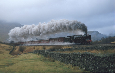 71000 'Duke of Gloucester' climbing the last few yards to Ais Gill Summit. This is the normal sort of weather on the S&C, not bright sunshine! 5/2/94