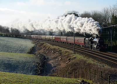 """45690 """"Leander"""" hauls a Manchester-Carlisle charter near Oxenholme with a shove from 37706 on the back 21/1/17."""