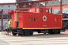 Lehigh & New England caboose 583 in front of the roundhouse.