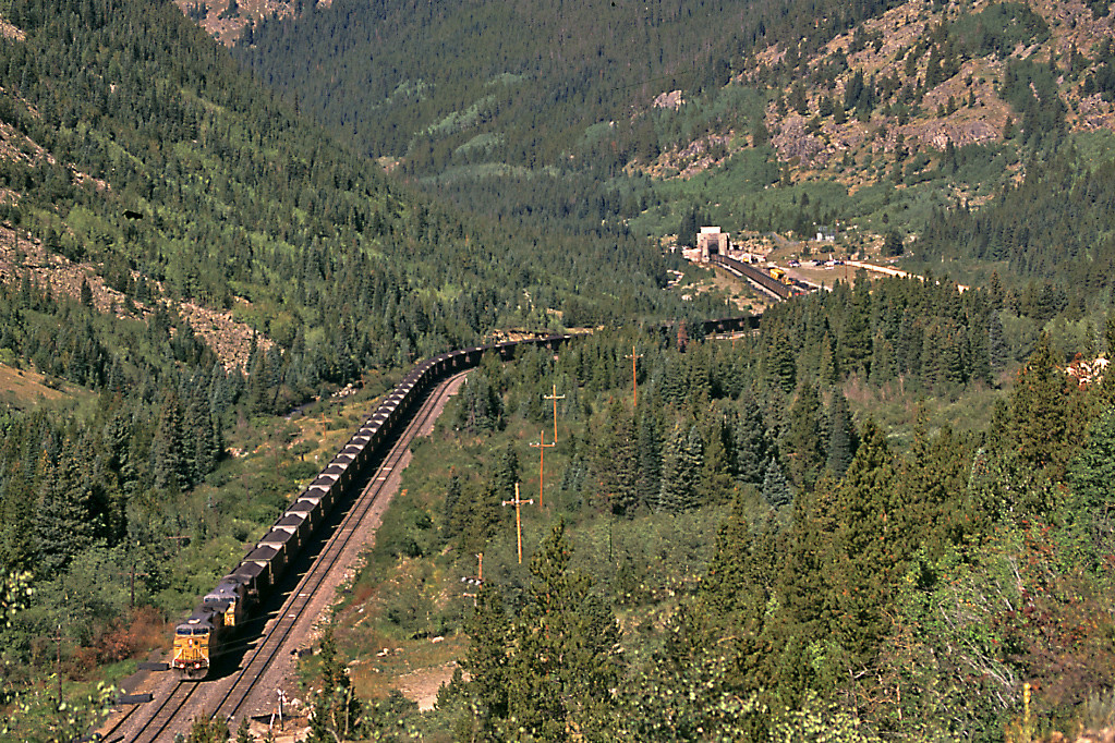 A coal train rolls out of the 6.2 mile long Moffat Tunnel.