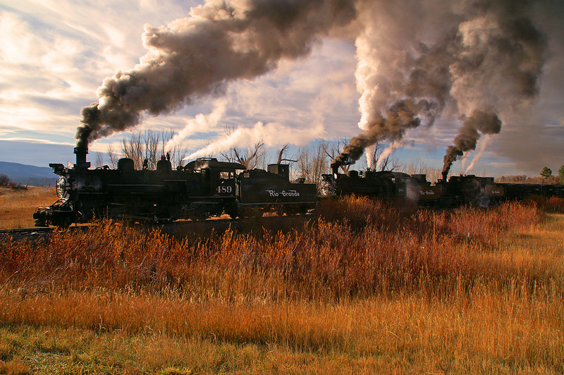 Rio Grande steam engines 489, 488, & 487 are backlit against the morning sun.