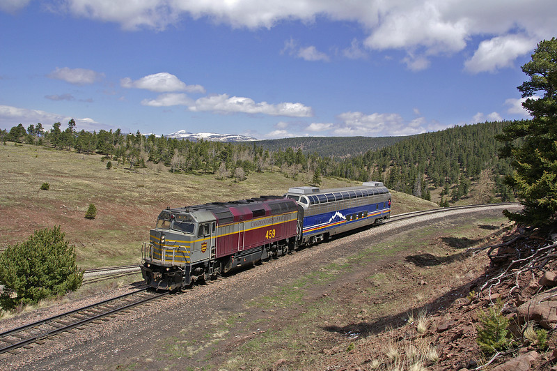 This location on the former Rio Grande can be reached either by the railroad or via a long narrow treacherous dirt road. No matter how you arrive the view is worth it. Seen here is the daily San Luis & Rio Grande passenger train enroute to Alamosa, CO