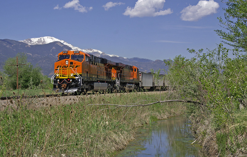 A loaded BNSF coal train rolls beneath the shadow of Pikes Peak on a gorgeous Colorado day.