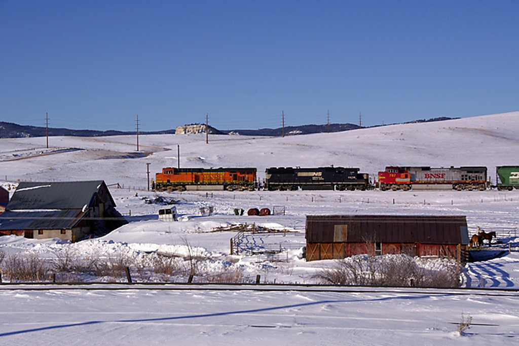 A train rolls through Greenland, CO after a recent snow fall.
