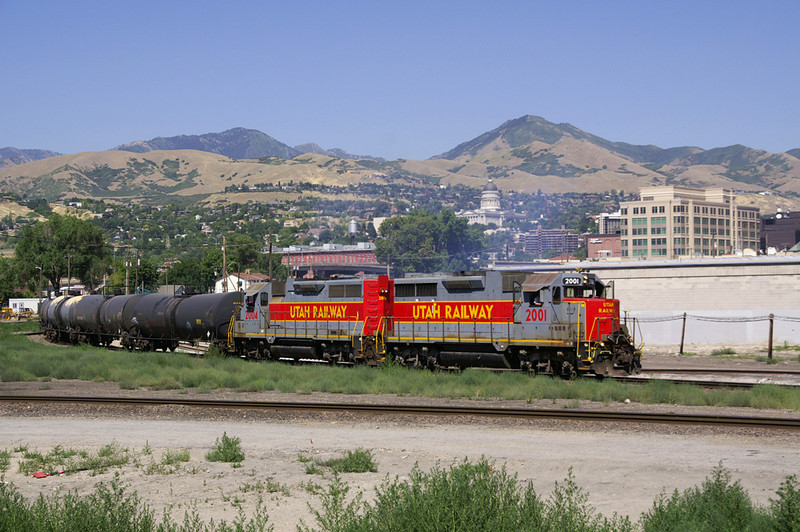 A Utah Railway local headed for Midvale curves through down town Salt Lake City. In the back ground is the Utah State Capitol.