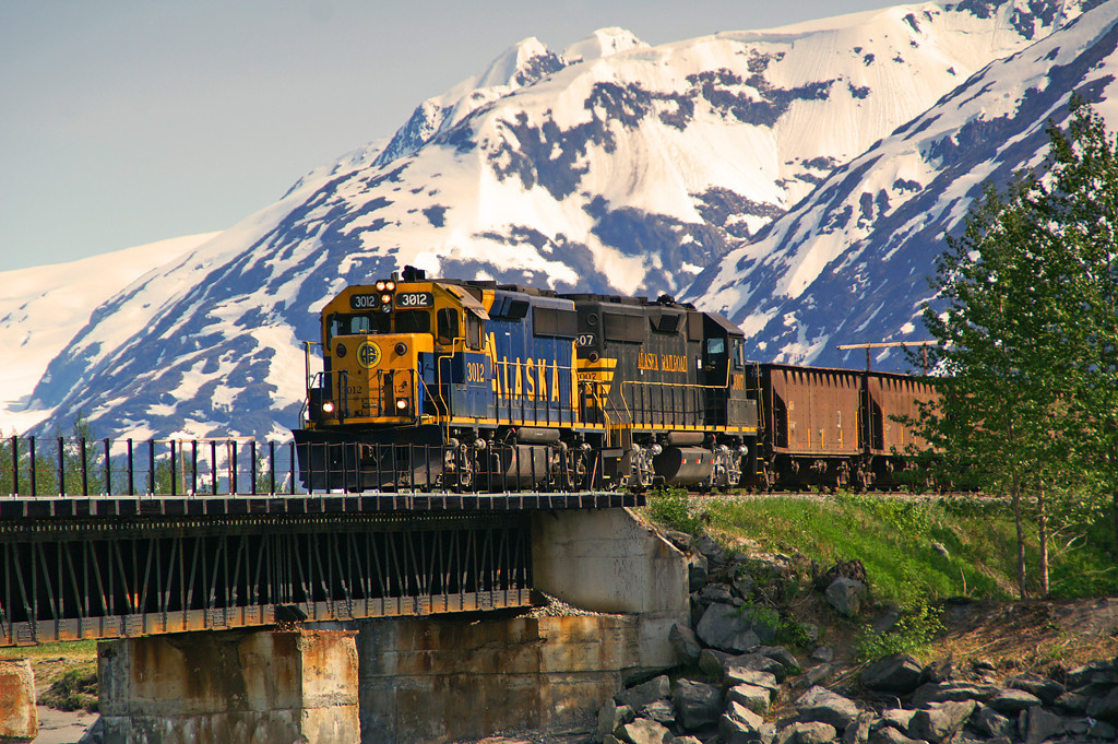 Having spent the morning dumping ballast an Alaska Railorad work train crosses the bridge over 20 Mile River on a fine Alaska afternoon.
