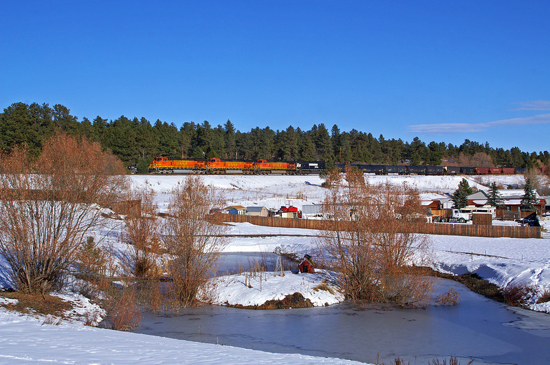 A southbound BNSF manifest rolls through the community of Larkspur on a nice winters days.