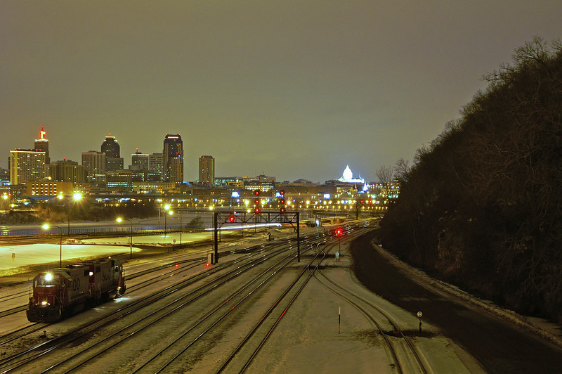 A pair of Soo locomotives idle the night away in Minneapolis, MN. In the background is the St Paul skyline including the state capital building.