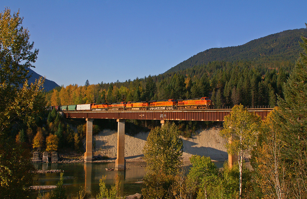 A BNSF High Priority Manifest rolls across the high bridge at Coram, MT