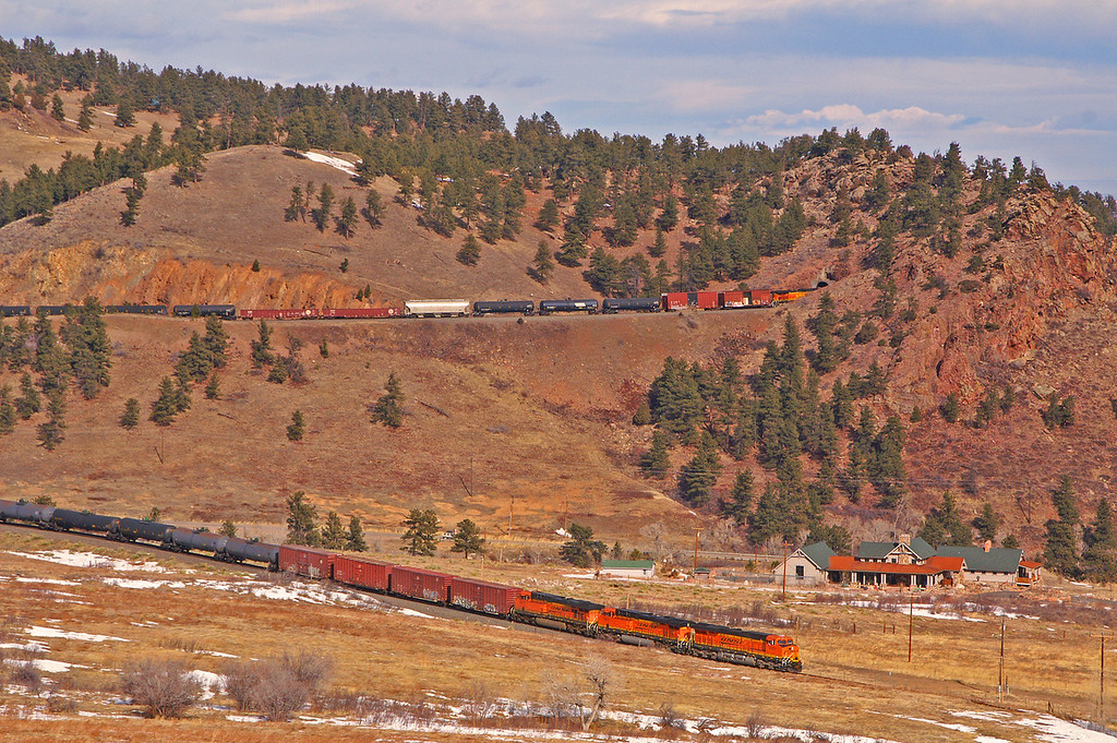 BNSF 6351 is about to cross Blue Mountain Road while the DPU is exiting Tunnel 1 on the former Rio Grande mainline.