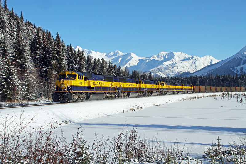 Alaska Railroad empty coal train rounds the curve at Girdwood headed north for another load of black diamonds and a return to the southern Port of Seward, Alaska.