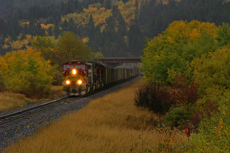 In a pouring rain storm a coal train is minutes away from Bozeman, MT on the way to an Oregon power plant.