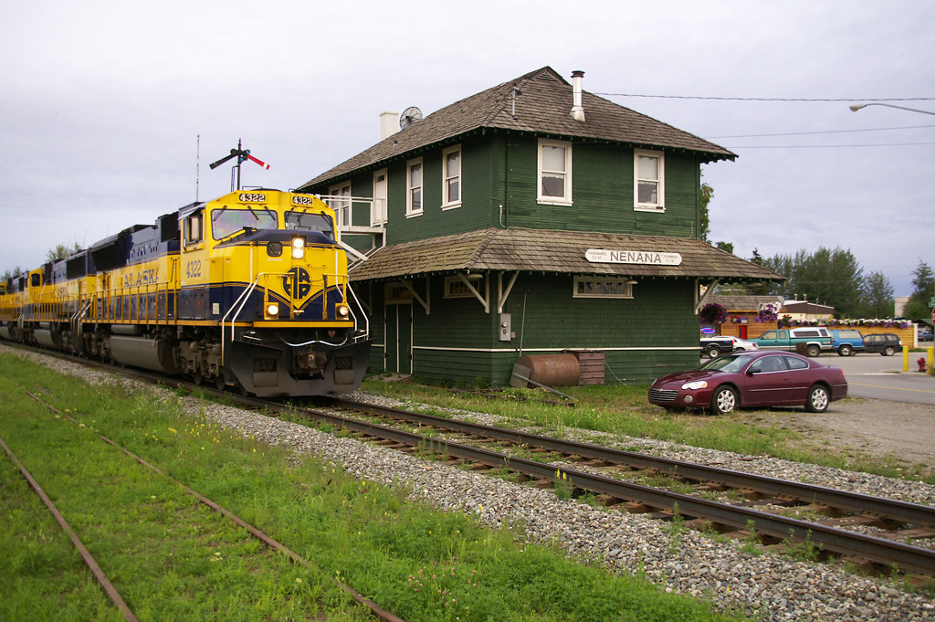 Having left Fairbanks a couple of hours ago Alaska Railroad's evening freight passes the depot at Nenana, AK