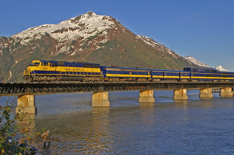 Alaska Railroad's Coastal Classic is returning to Anchorage after spending the day in Seward. Seen here crossing 20 Mile River just oustside Portage, Alaska.