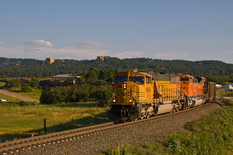 A BNSF coal train leans into the curve just north of Monument, Colorado.