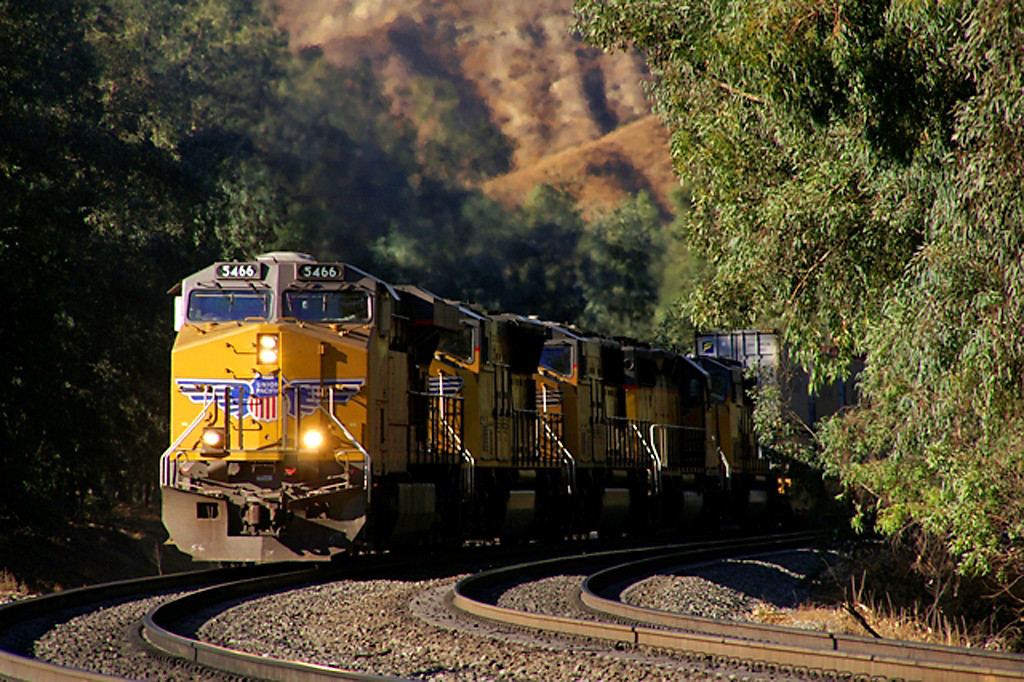 A UP double stack train negotiates the tight confines of San Timeteo Canyon enroute to an eastern destination.
